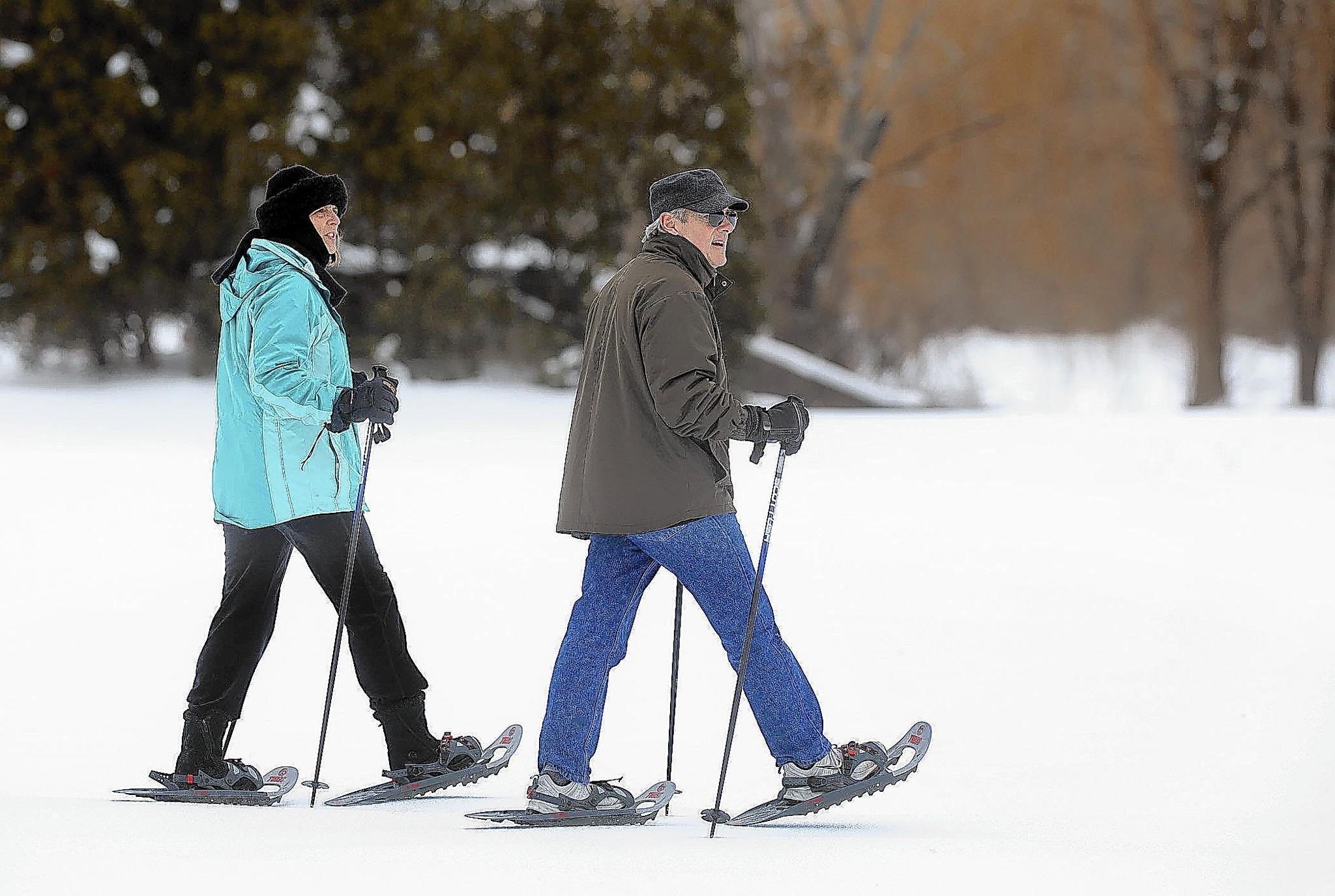 Tina Madonia-Brown (left) along with her husband Bill Brown (right) both of North Whitehall snow-shoe during the Allentown Winterfest 2014.