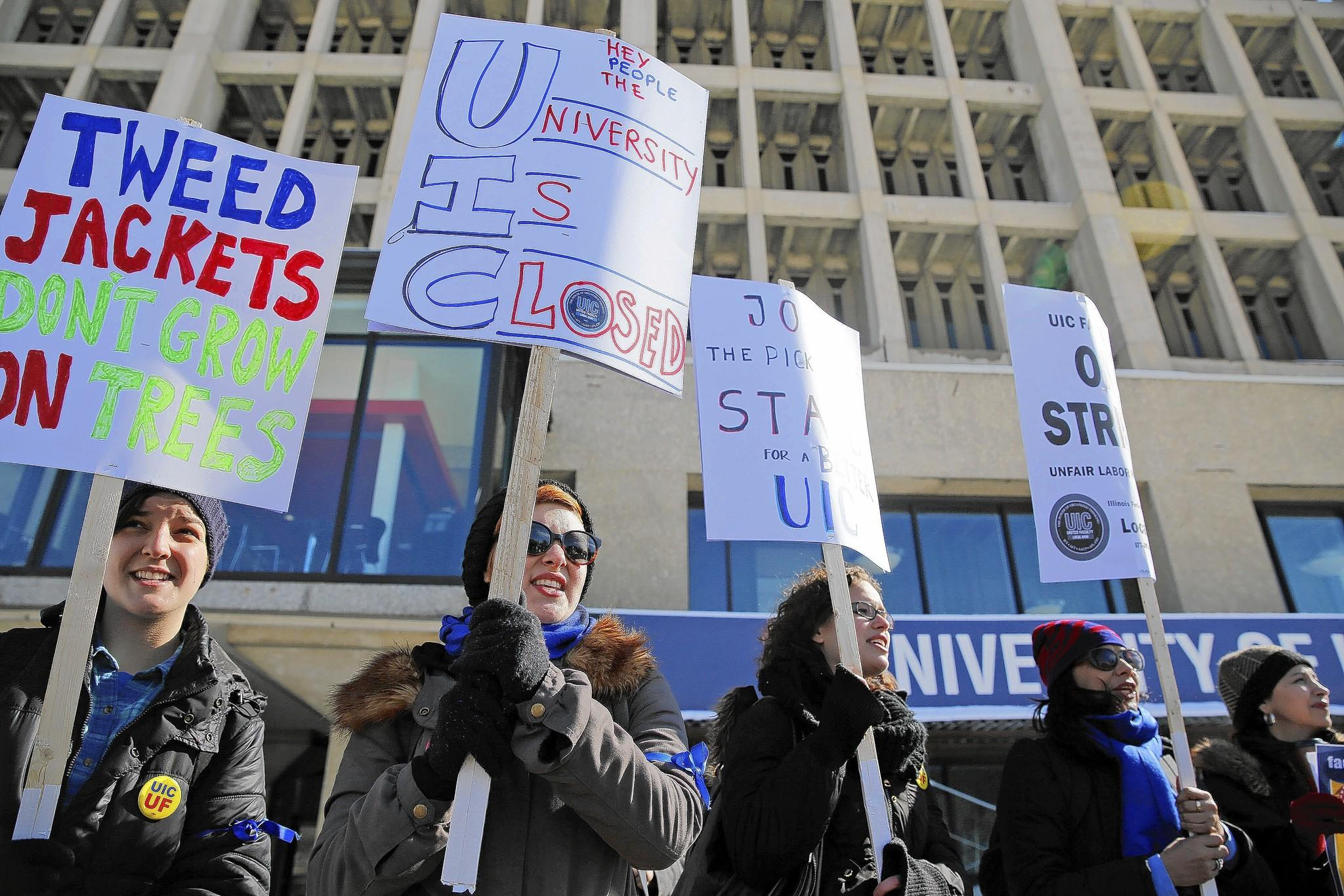 Faculty members and supporters march at the University of Illinois at Chicago on Wednesday. The two-day walkout, which canceled many classes, was aimed at focusing attention on the lack of contract, and salaries and benefits.