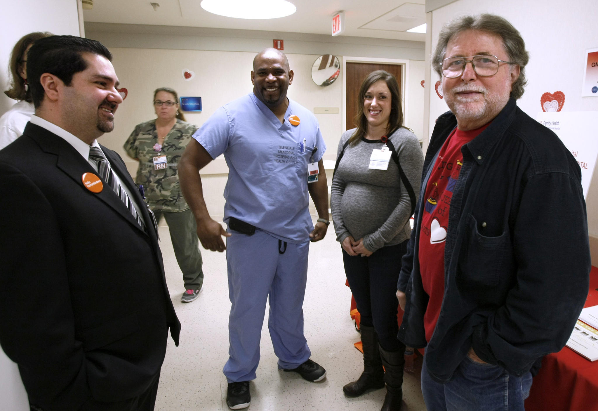 Rudy Donofrio, 66 of Glendale, right, got a chance to meet hospital employees and locals who helped saved his life about 6 months ago when he was having a heart attack in front of the hospital -- Howard Ferguson, left, and Michelle Carmichael, right -- during the Kings and Queens of Heart celebration at Glendale Memorial Hospital in Glendale on Thursday, Feb. 20, 2014.