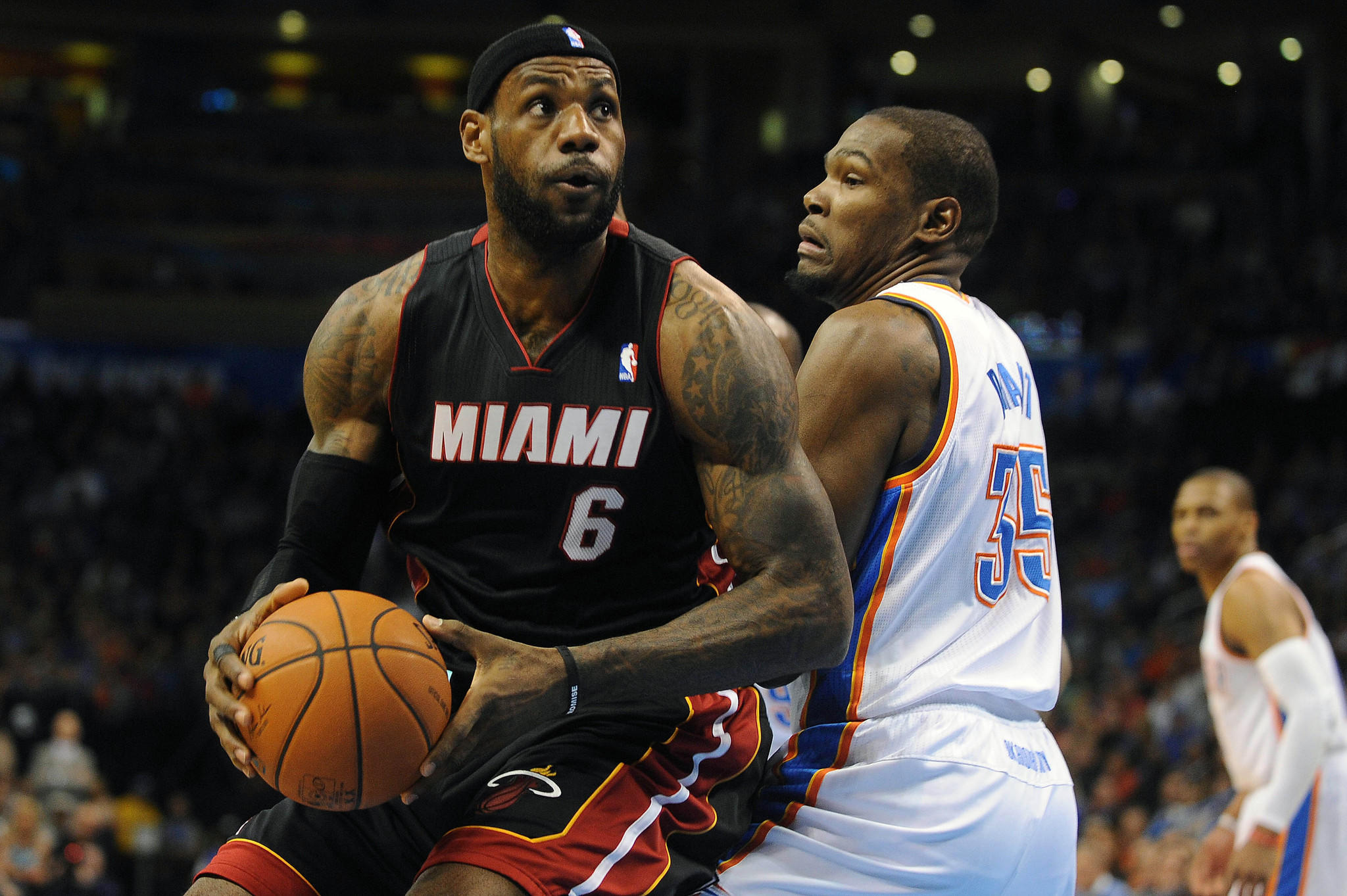 Miami Heat small forward LeBron James (6) handles the ball while being guarded by Oklahoma City Thunder small forward Kevin Durant (35).