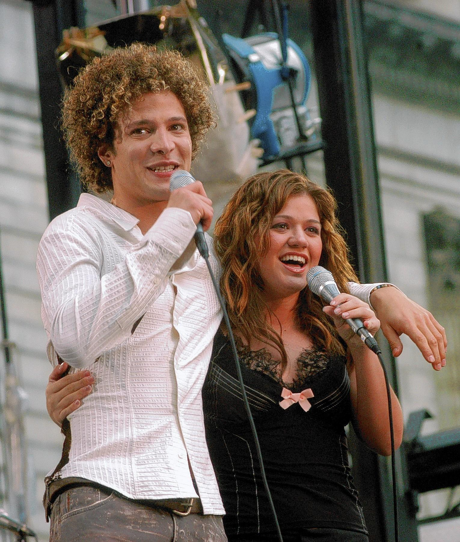 Justin Guarini and Kelly Clarkson perform during 'Good Morning America's' 2003 Concert Series. Guarini reveals in his one-man cabaret show last weekend that the two had an affair.
