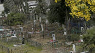 Sochi Winter Games: Amid Olympic venues, a cemetery rests in peace