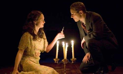 "Michelle Federer plays Laura Wingfield and Kevin Isola is Jim O'Connor in The Old Globe's production of the Tennessee Williams' classic play, ""The Glass Menagerie."""