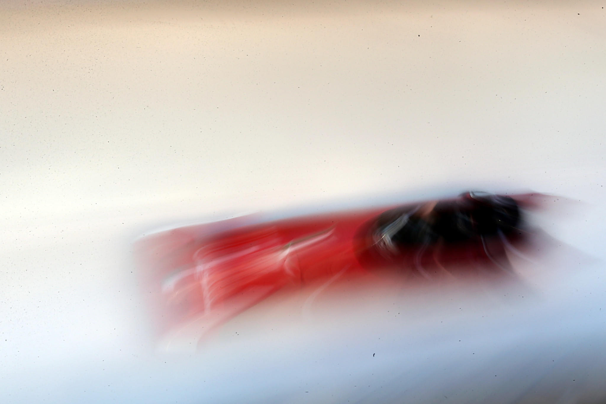 A bobsled team, including William Frullani of Italy, whiz by during competition in Germany ahead of the Olympics.