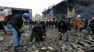 Snipers kill 20 protesters in Ukraine; allies turn against Yanukovich