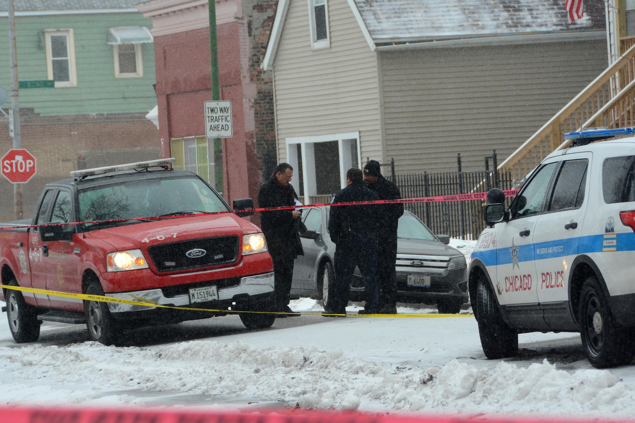 Chicago Police and Chicago Fire departments investigate a fire in the 8300 block of South Baker in Chicago where a man was found dead.