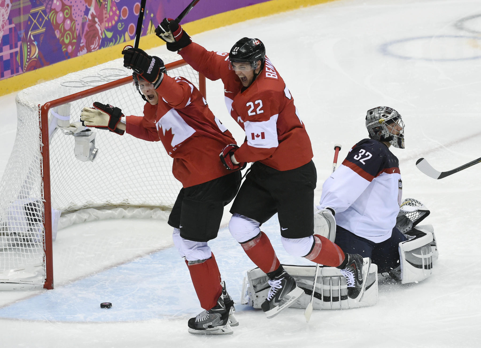 Canada forward Jamie Benn (22) celebrates with forward Corey Perry (24) after scoring a goal Friday.