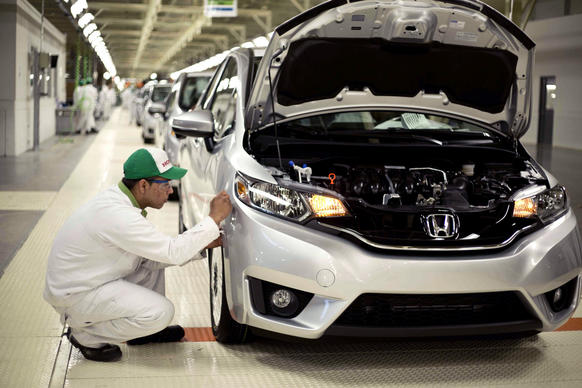 The first Honda Fits roll off the assembly line at a new $800-million factory near Celaya, Mexico. The country's network of free-trade agreements makes it easier to export products made there, including vehicles.