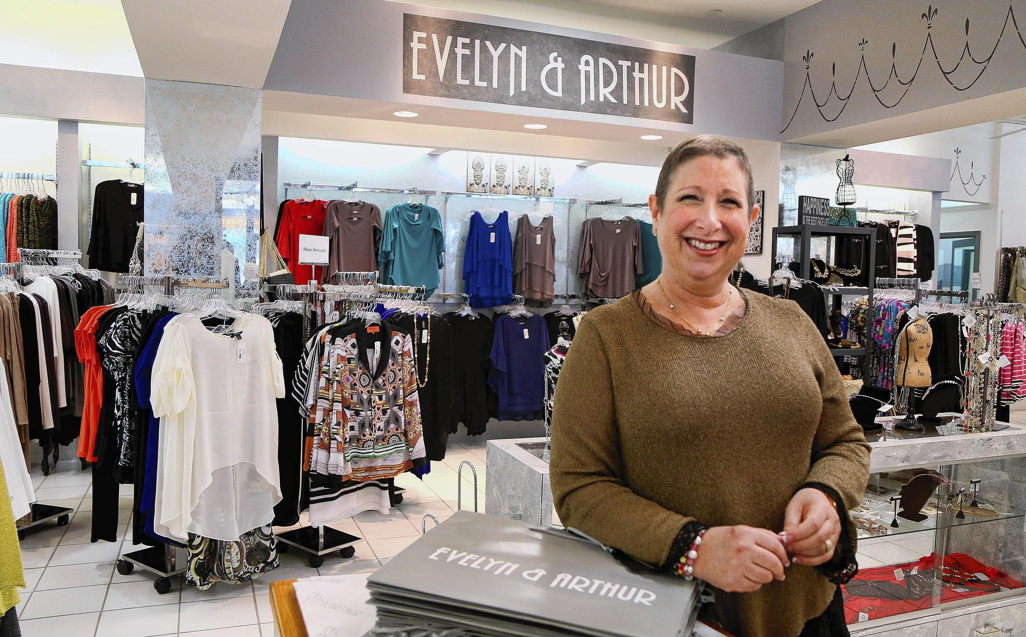 Three years after taking over her parents' Evelyn & Arthur chain of clothing stores, Adrianne Weissman has hit upon an unconventional marketing approach that works: helping local charities.