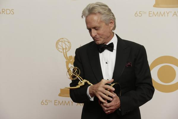 "Michael Douglas cradles his Emmy for HBO's ""Behind the Candelabra"" at last year's Emmy Awards."