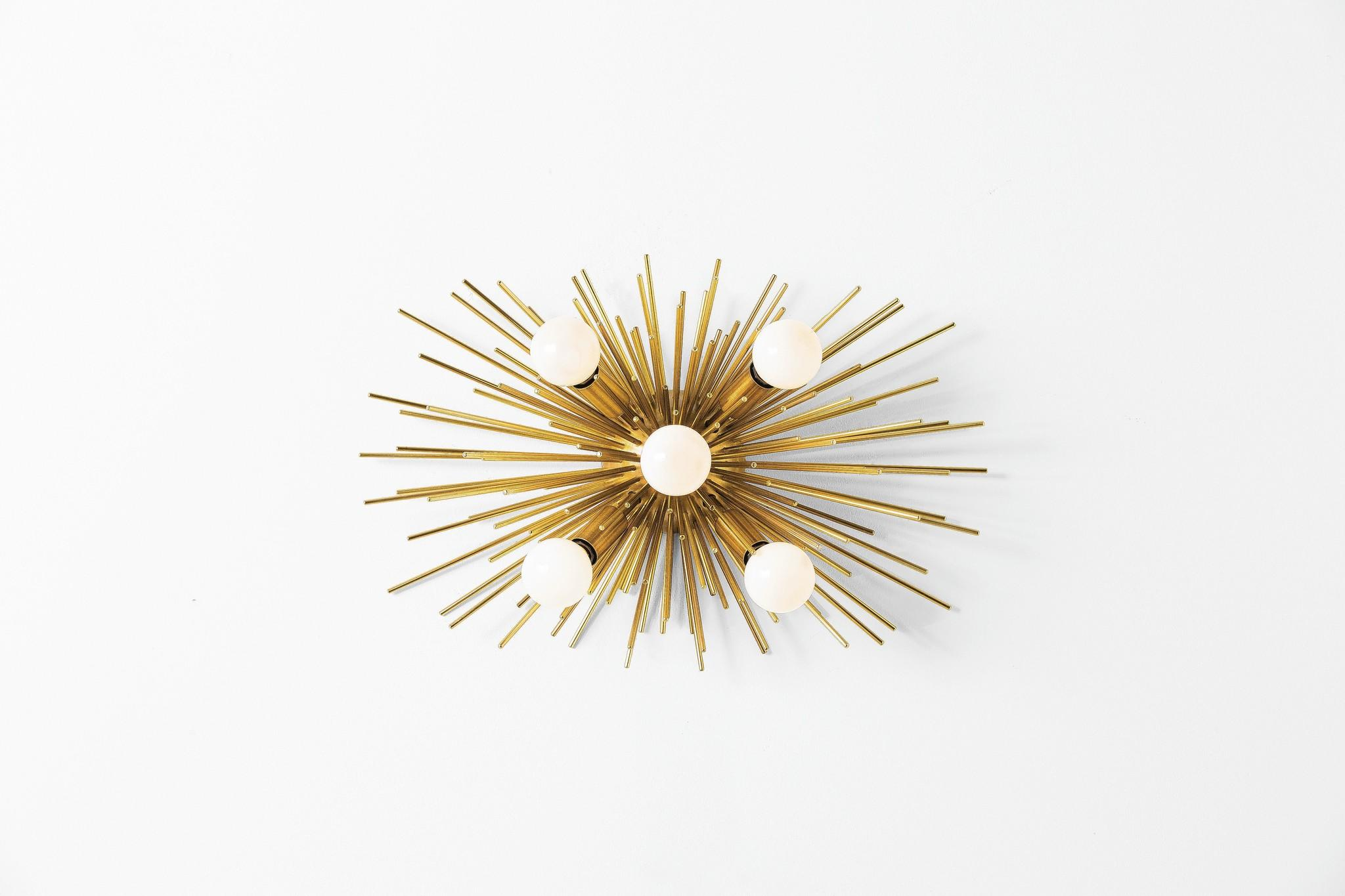 This brass wall sconce from arteriors makes a bold statement.