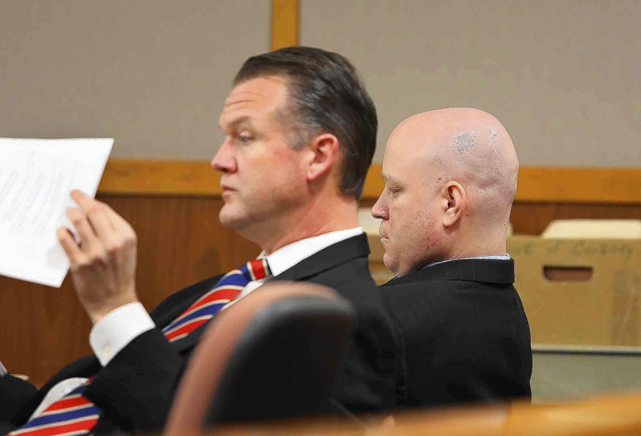 Convicted killer Eric Simmons, right, sits with his attorney, Chief Assistant Public Defender John Spivey, in court on Tuesday, February 13, 2014.