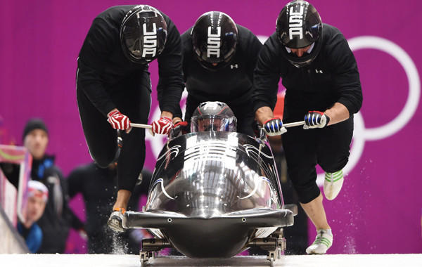 USA's four-man bobsled team takes part in a training run at the Sochi Winter Olympic Games on Wednesday. Pilot Steven Holcomb, sitting in bobsled, is dealing with a calf injury that could threaten the team's chances at winning gold.