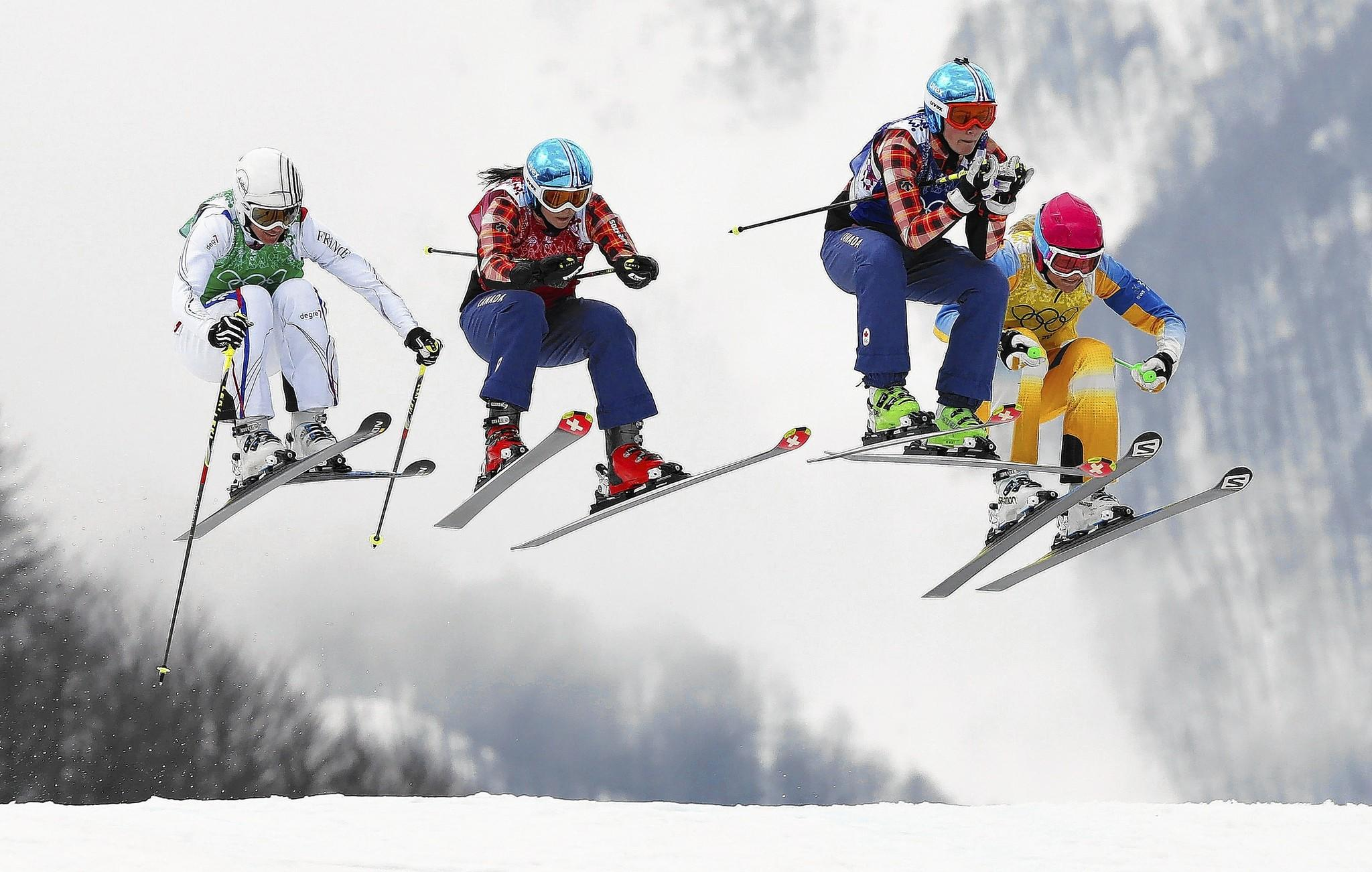 France's Ophelie David, from left, Canada's Kelsey Serwa, Canada's Marielle Thompson and Sweden's Anna Holmlund compete in the women's ski cross at the Winter Games in Sochi, Russia.
