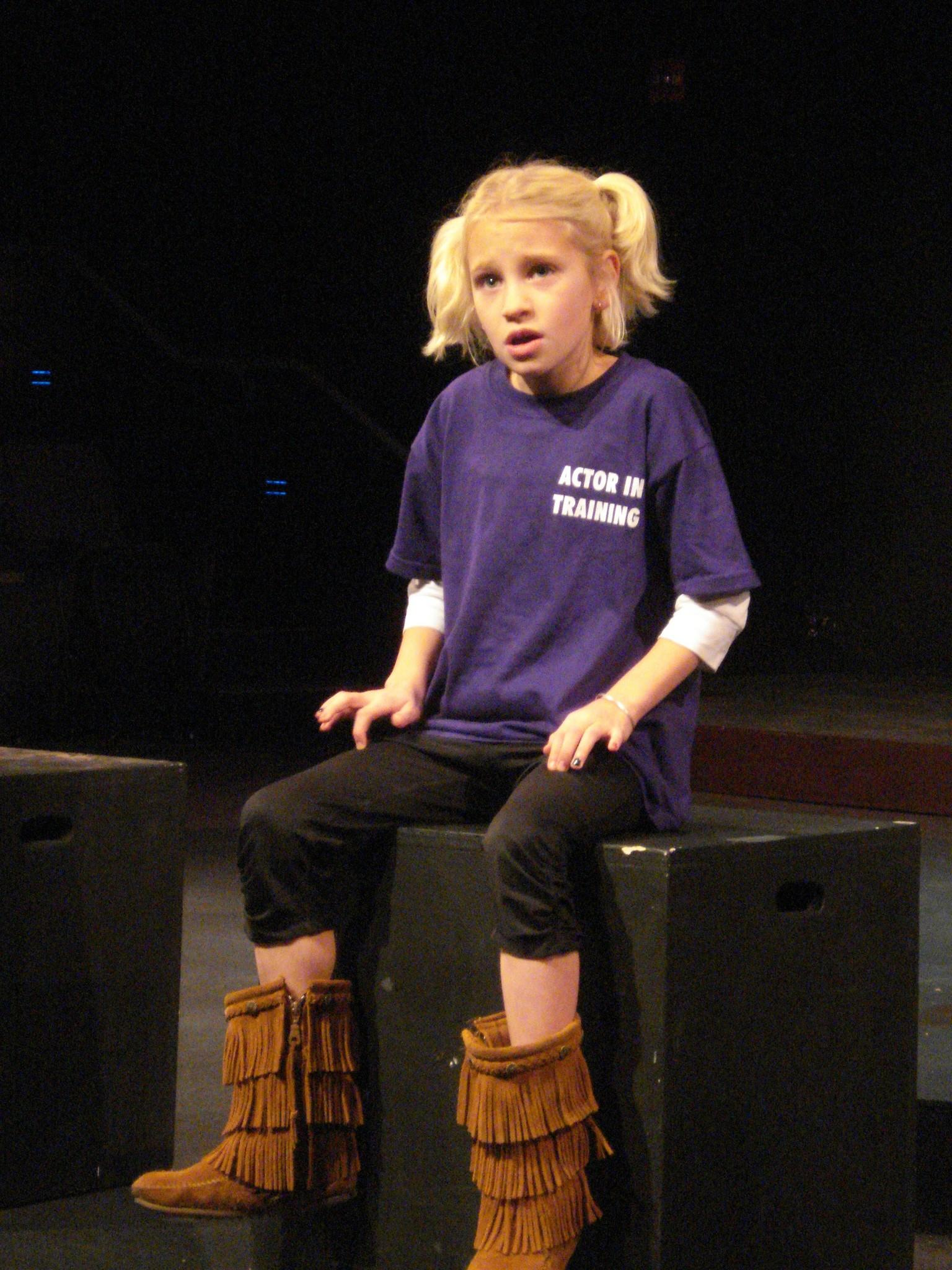 An actor-in-training takes the stage in an acting class at Playhouse on Park.