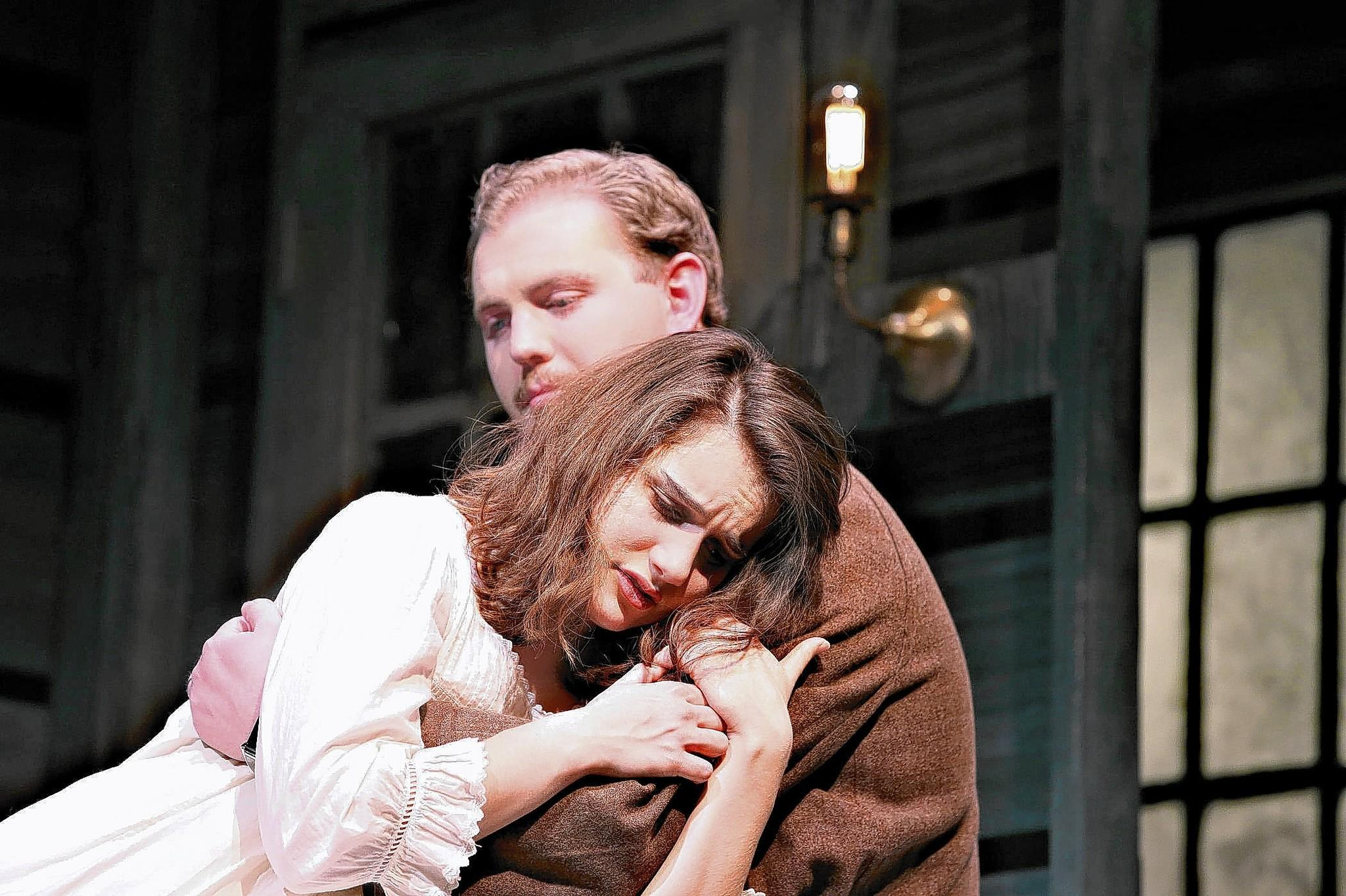 Anne Frank (Emma Santschi) is comforted by her father (Brett Lawlor) after having awakened from a nightmare in DeSales University's Act 1 production of 'The Diary of Anne Frank.'