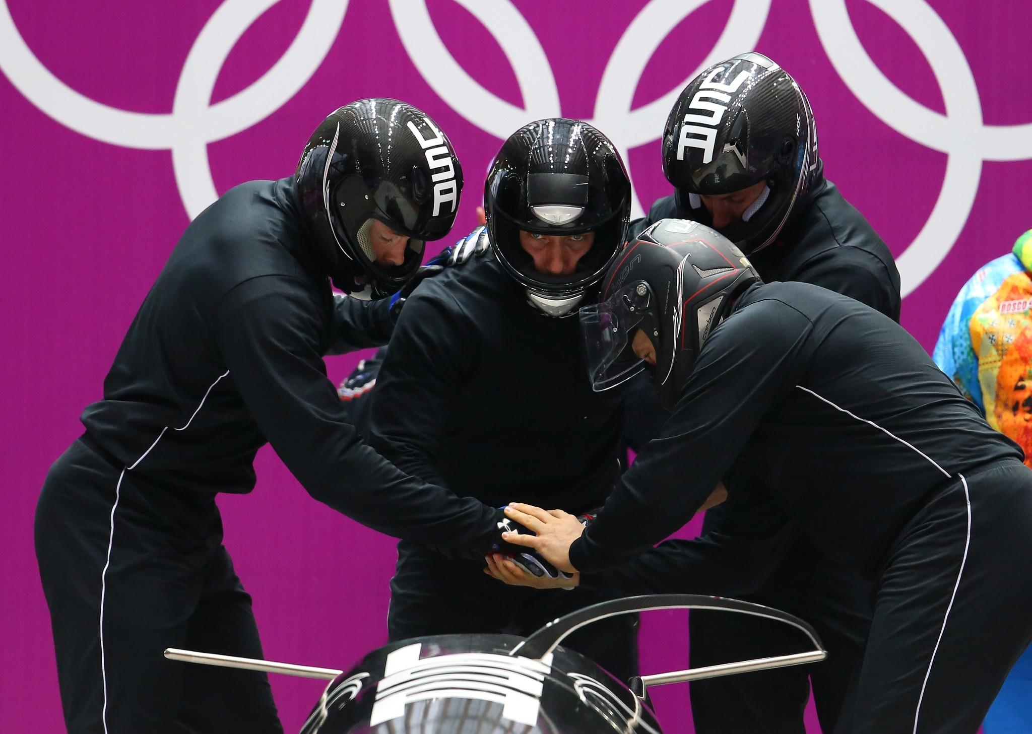 Steven Holcomb of USA and his crew prepare to start during a four-man bobsleigh practice session on Day 14 of the Sochi 2014 Winter Olympics at Sliding Center Sanki on February 21, 2014 in Sochi, Russia.