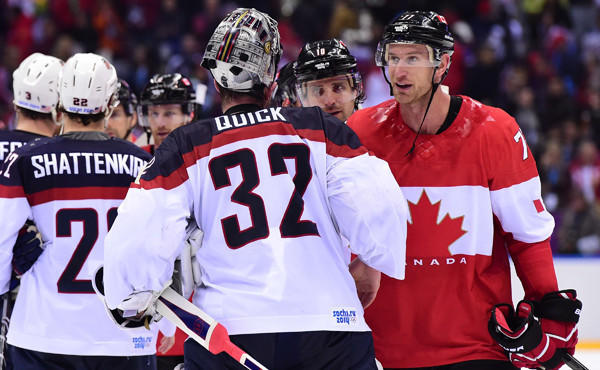 Team USA goalie Jonathan Quick, left, shakes hands with Kings teammate and Team Canada forward Jeff Carter during Canada's 1-0 semifinal win at the Sochi Winter Olympic Games on Friday.