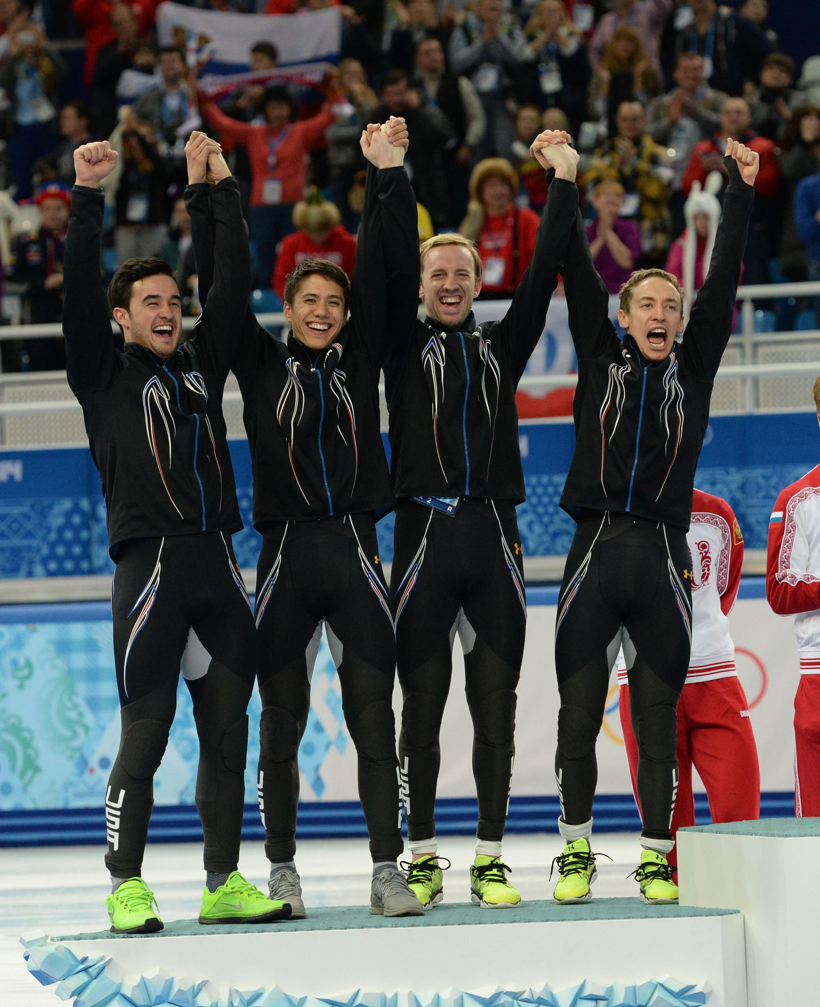 Team USA celebrates their silver medal in short track speed skating men's 5000m relay in the Sochi 2014 Olympic Winter Games at Iceberg Skating Palace. They are from left, Eduardo Alvarez, J.R. Celski, Chris Creveling, and Jordan Malone.