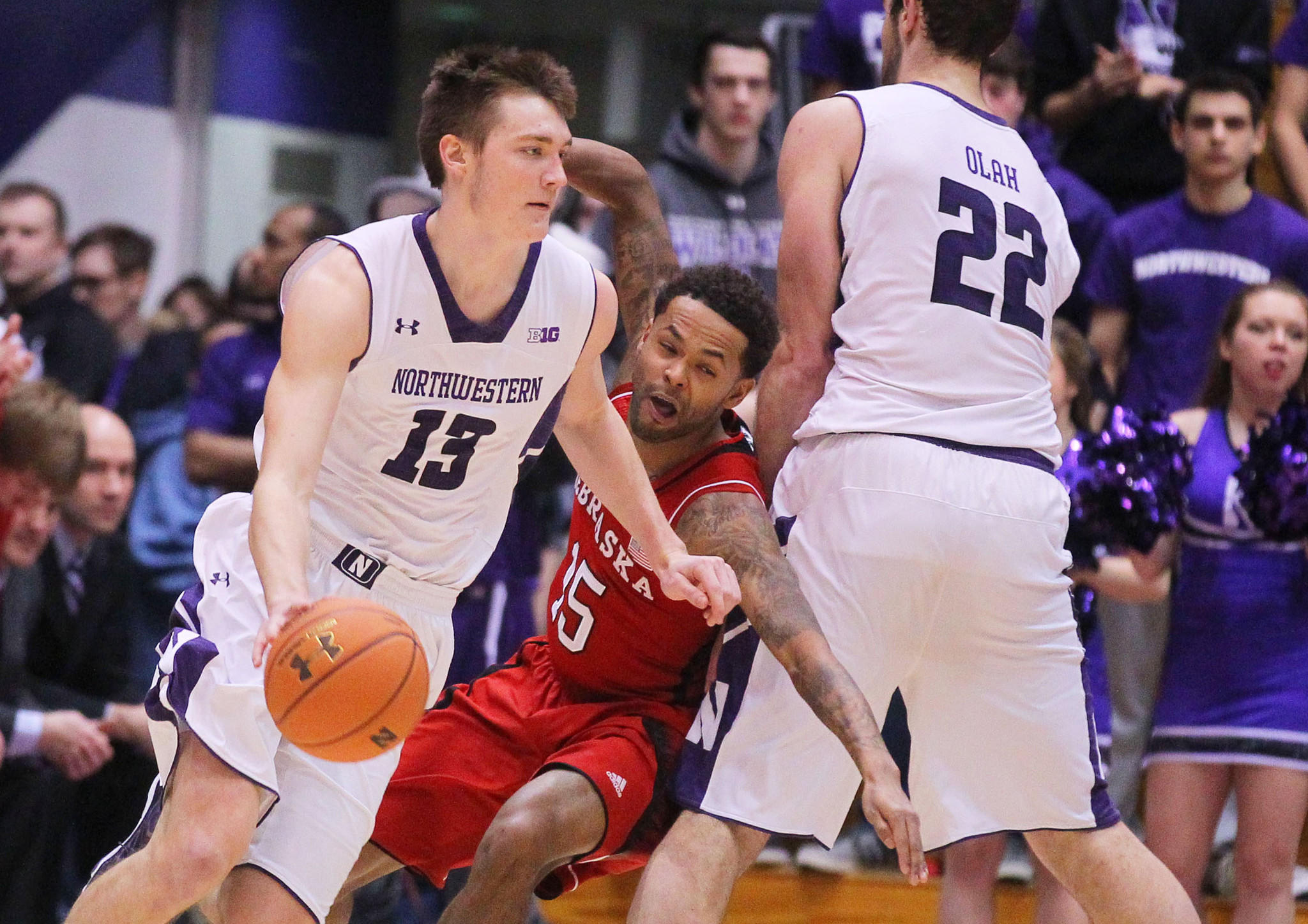 Northwestern Wildcats forward Kale Abrahamson (13) is defended by Nebraska Cornhuskers guard Ray Gallegos (15) during the first half at Welsh-Ryan Arena.