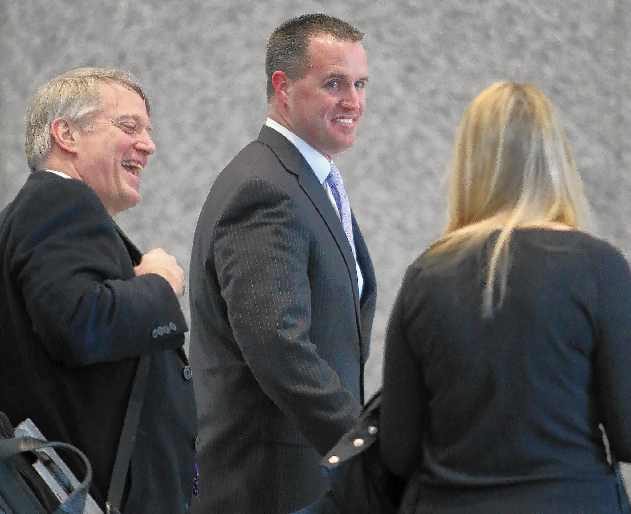 "At a labor hearing Friday in Chicago, Northwestern University head football coach Pat Fitzgerald, center, sought to paint his program as stressing academics above football, saying his goal is to prepare student-athletes to be ""champions in life"" and earn a college degree. ""I teach life lessons on a daily basis,"" he said."