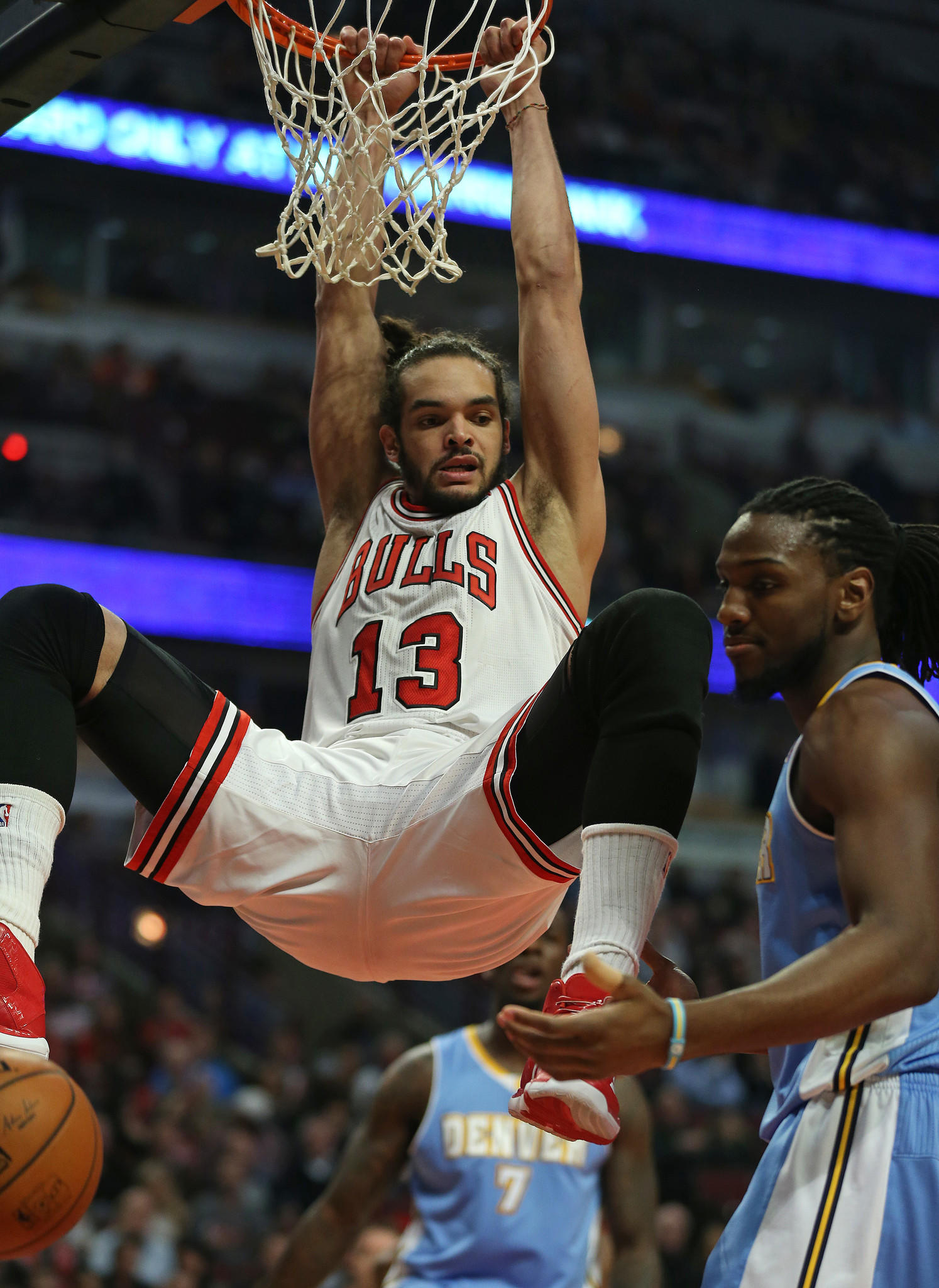 Joakim Noah of the Chicago Bulls (13) looks at Kenneth Faried of the Denver Nuggets (4) during a dunk in the first half at the United Center Friday, Feb. 21, 2014, in Chicago.