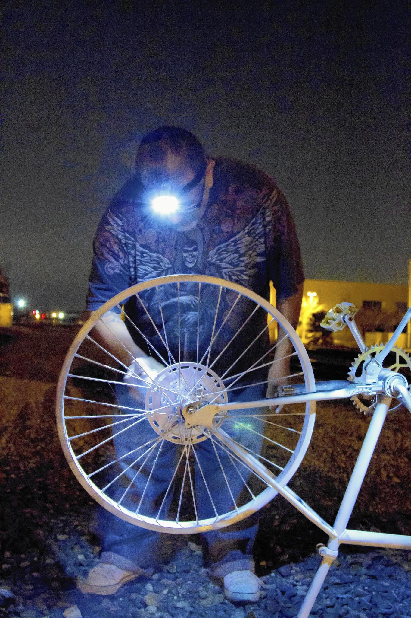 Anthony Navarro prepares a ghost bike memorial for a Whittier cyclist killed in Santa Fe Springs.