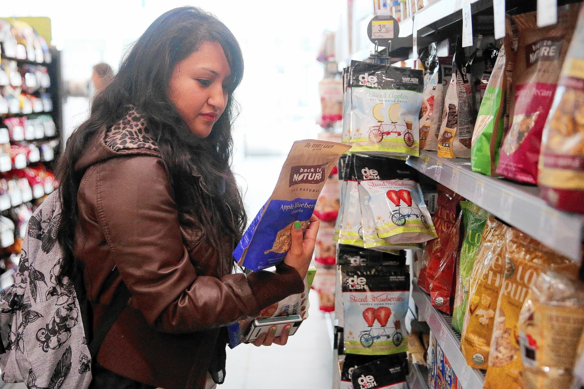 Sara Ordonez, a 23-year-old business student at Harold Washington College, said she snacks to stay energized for class and less ravenous when she gets home for dinner around 8 p.m. She's fond of the new blueberry belVita biscuits. Trend watchers say snacking is replacing the traditional three meals a day.