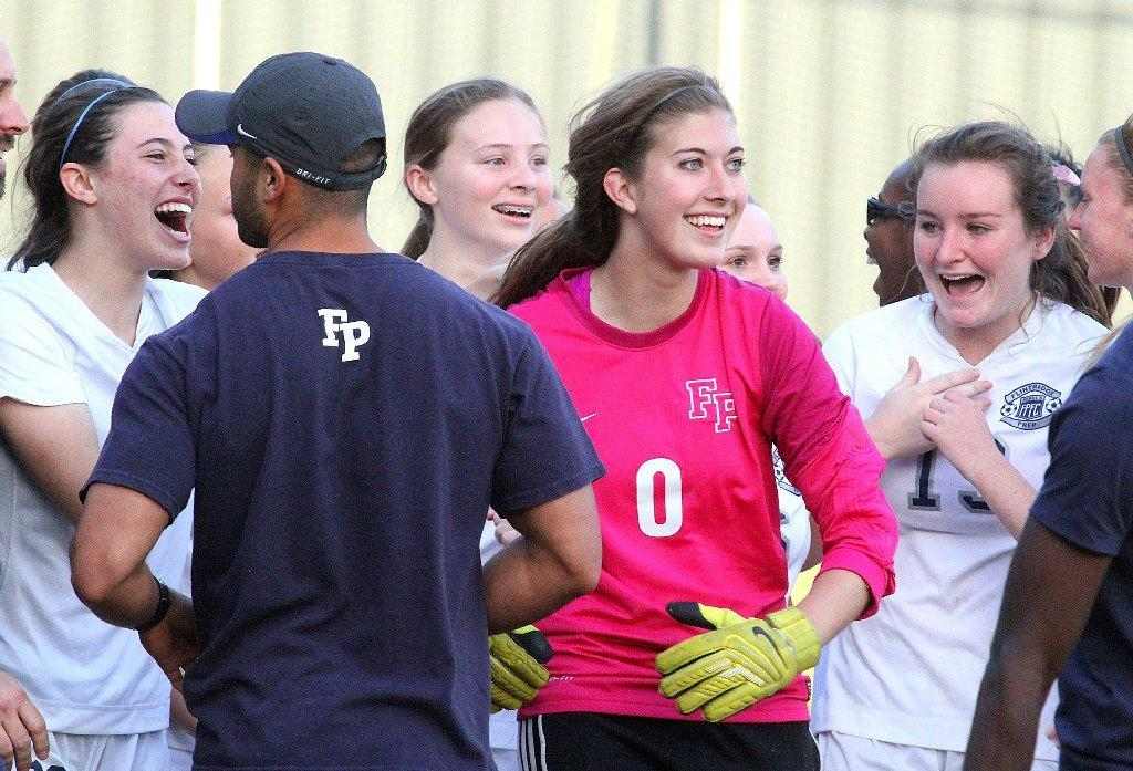 Flintridge Prep goalie Lauren Stiles is congratulated after the Rebels' playoff win on Friday.