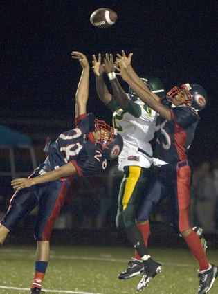 Grafton's Nick Person, left, and Aaron Wallace tip a pass into the air intended for Bruton's DeAndre Parker in the third quarter Friday, Sept. 12, 2008, during a game at Bailey Field in York County. Parker caught the tipped ball and scored a touchdown on the play. Bruton won 7-6.