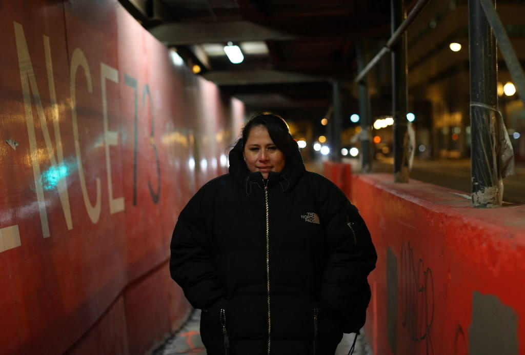 Rocio Caravantes walks to work, around 10:45 p.m., after riding a bus and a Red Line train, on Jan. 29, 2014, to one of her three part-time jobs, Wednesday, Jan., 29, 2014.
