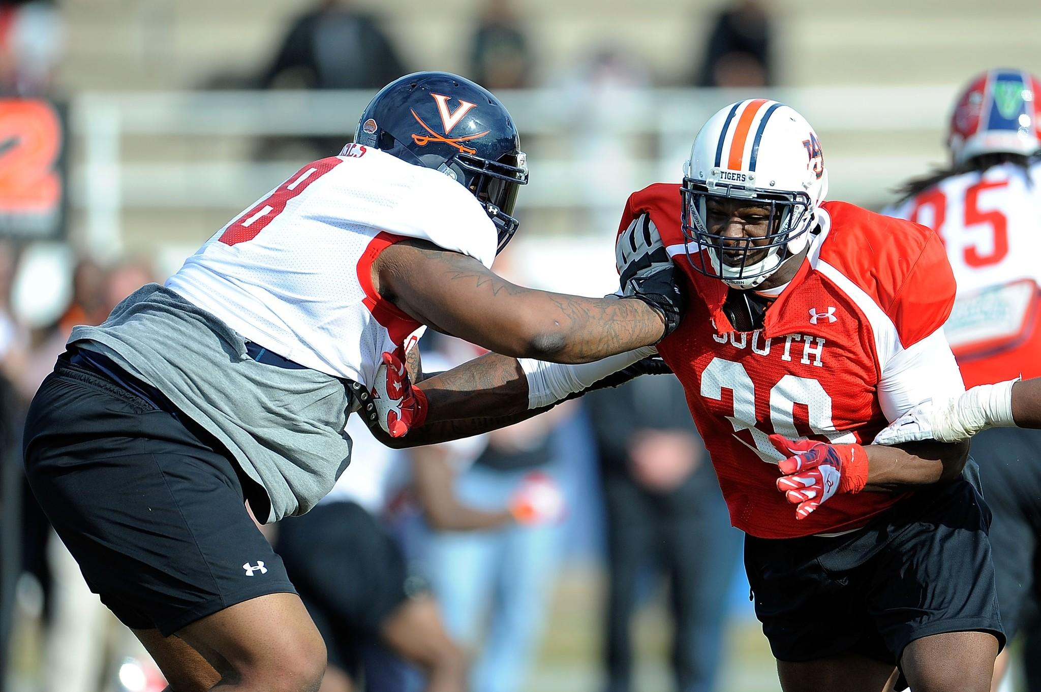Dee Ford #30 of the South team works against Morgan Moses #78 during a Senior Bowl practice session at Fairhope Stadium on January 20, 2014 in Fairhope, Alabama.
