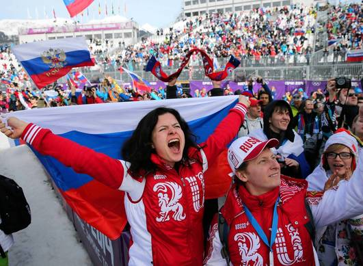 Russians celebrate a gold medal win by Vic Wild of Russia in men's snowboard parallel slalom.