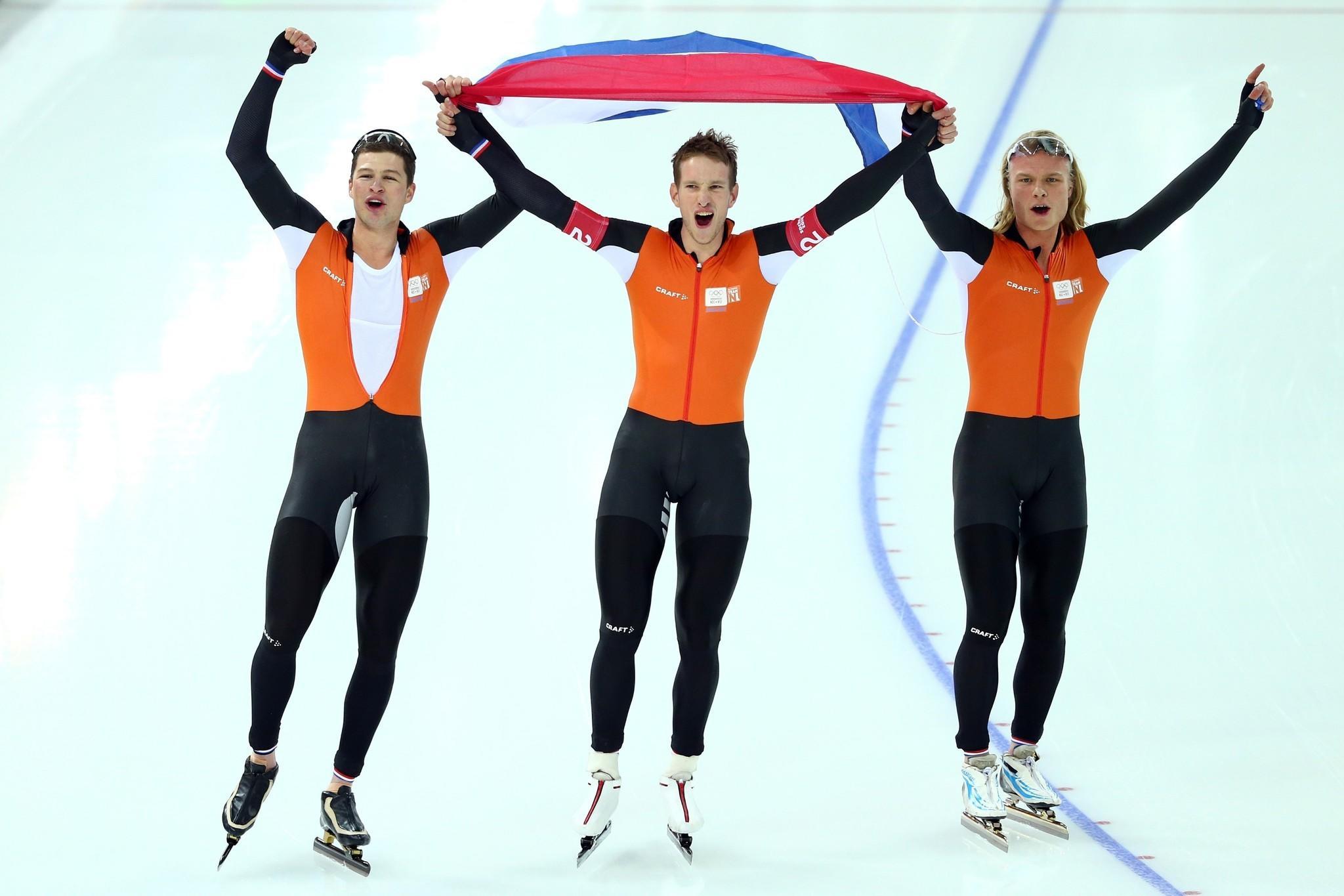 Sven Kramer, Jan Blokhuijsen and Koen Verweij of the Netherland celebrate winning the gold medal during the Men's Team Pursuit Saturday.