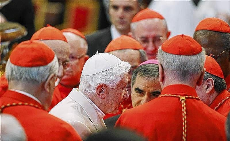 Pope Emeritus Benedict XVI is greeted by Cardinals as he arrives to attend a consistory ceremony in Saint Peter's Basilica.