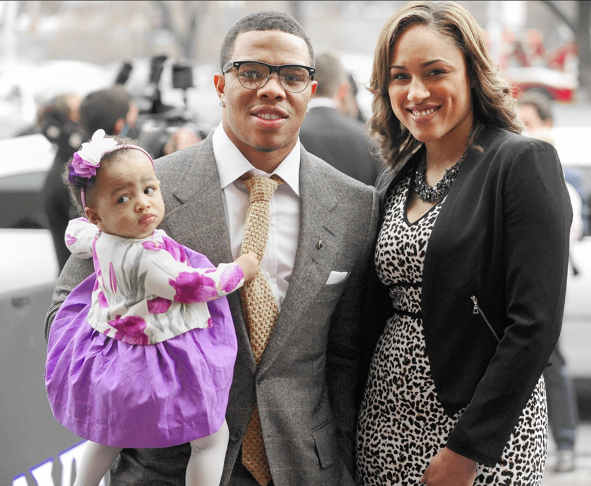 Ray Rice, daughter Rayven and girfrield Janay Palmer attend a team event at the Lyric Opera House in 2013.