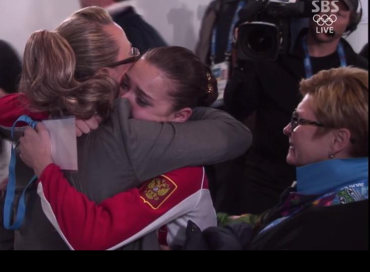 Russian judge Alla Shekhovtseva hugging gold medalist Adelina Sotnikova.