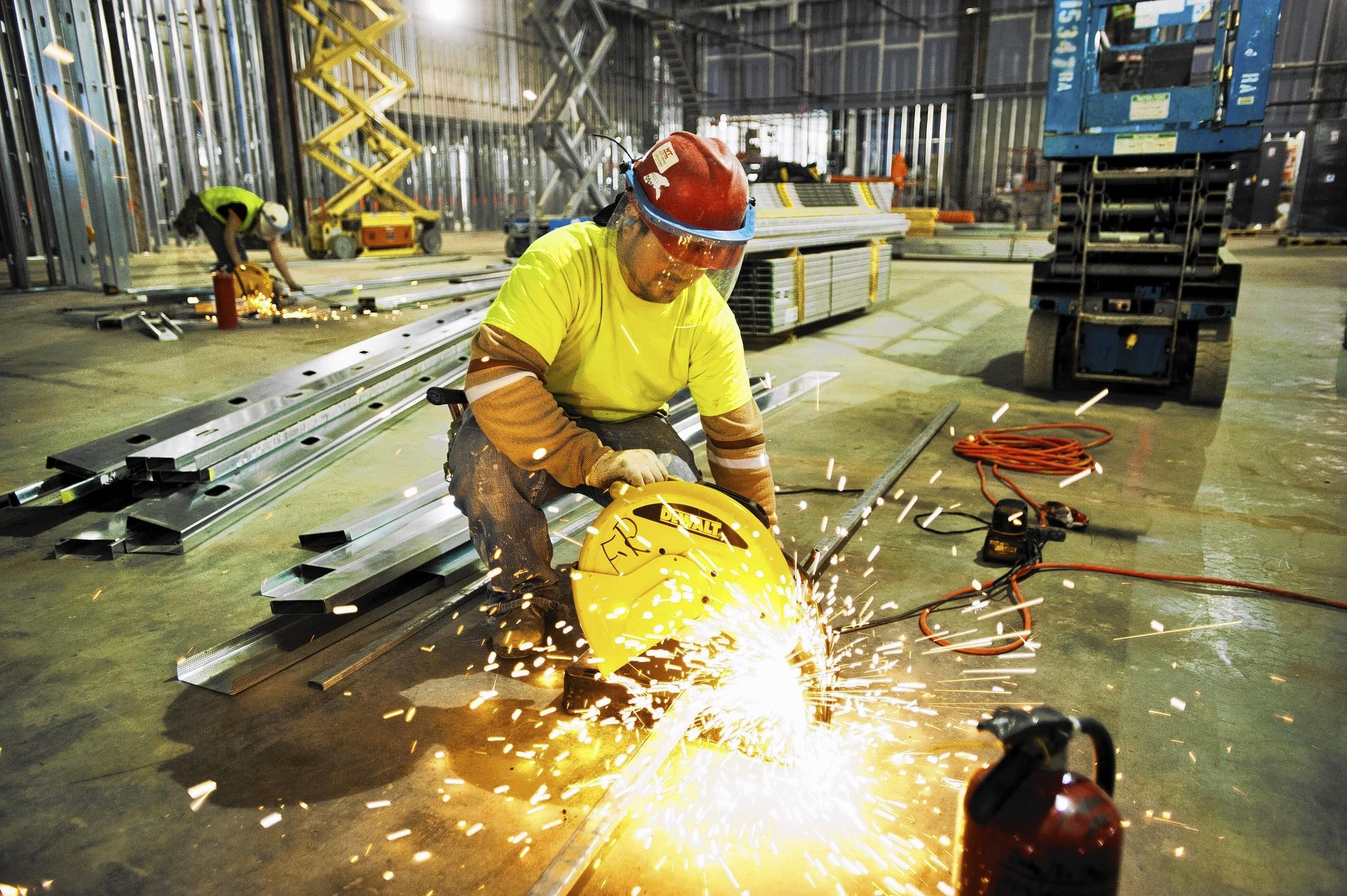 Construction worker David Quintanilla cuts steel supports before installation inside the Horseshoe Casino on Russell Street.