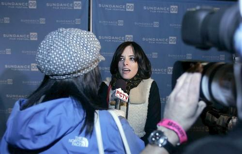 "<a class=""taxInlineTagLink"" id=""PECLB003440"" title=""Parker Posey"" href=""/topic/entertainment/parker-posey-PECLB003440.topic"">Parker Posey</a> works the press line before the screening of ""Spring Breakdown."""