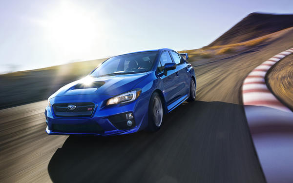 The 2015 Subaru STI has the same impressive turbocharged power as its predecessor, but adds a huge amount of refinement inside and outside of the car.