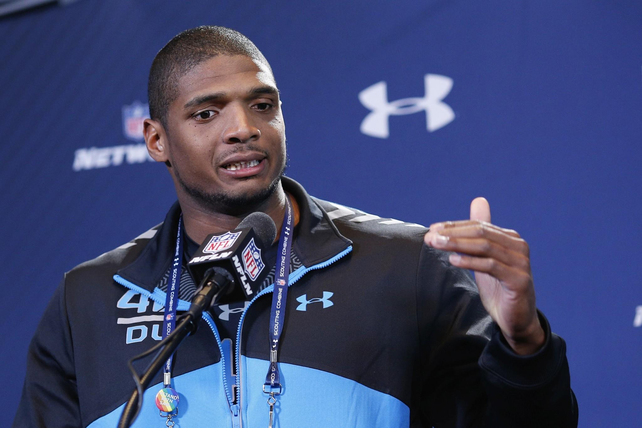 Former Missouri defensive lineman Michael Sam speaks to the media during the 2014 NFL Combine at Lucas Oil Stadium in Indianapolis.