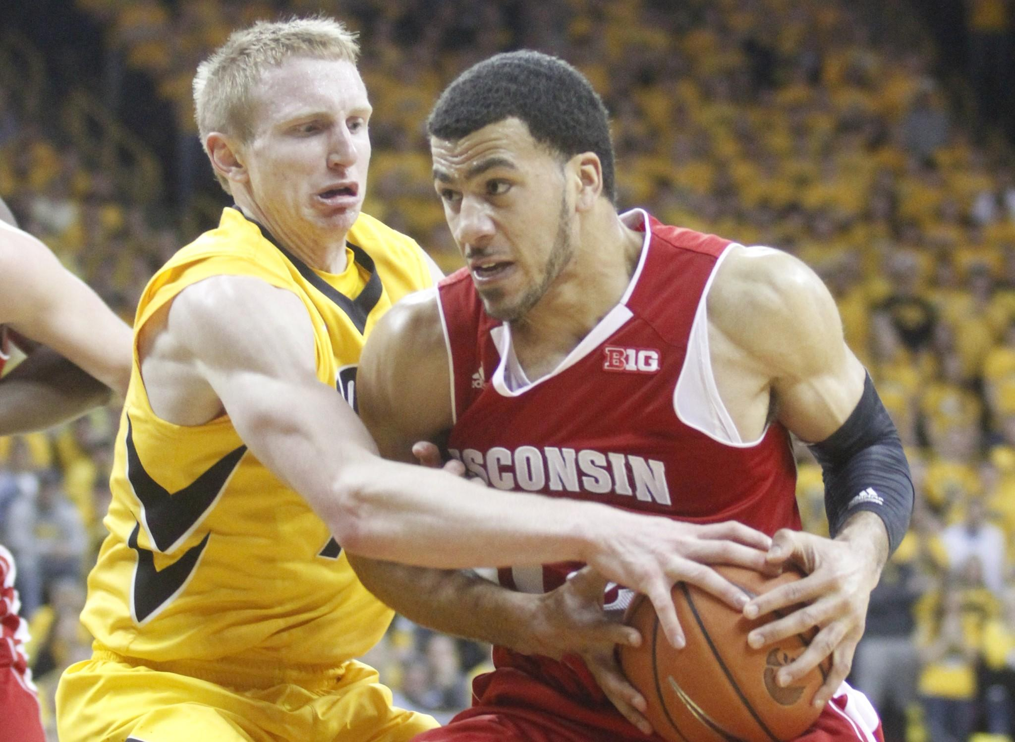 Guard Traevon Jackson of Wisconsin fights to keep tha ball away during the first half from guard Mike Gesll of Iowa.