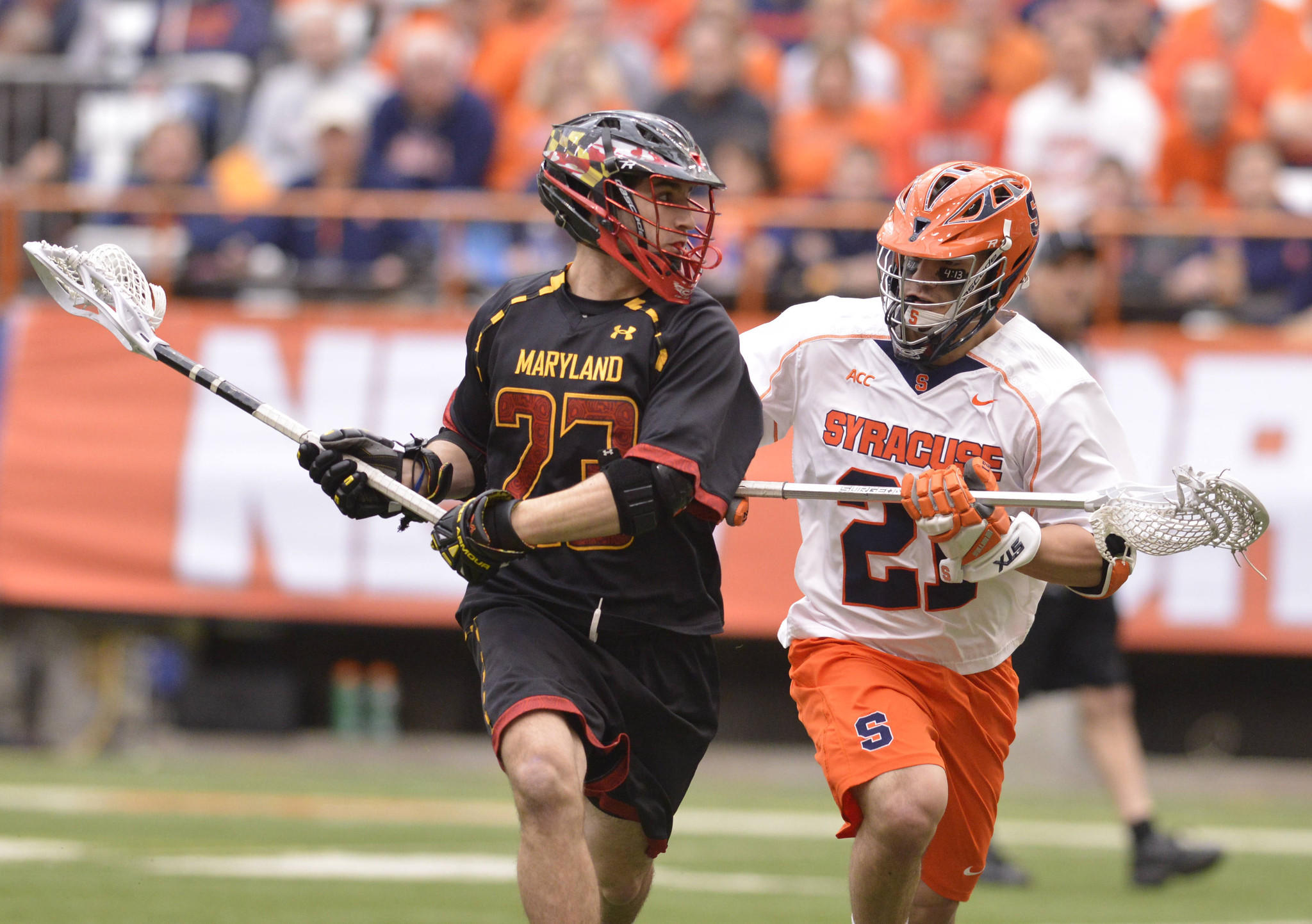 Maryland's Connor Cannizzaro cradles the ball as Syracuse's Mike Messina applies pressure during the first quarter of a blowout Terps win at the Carrier Dome.