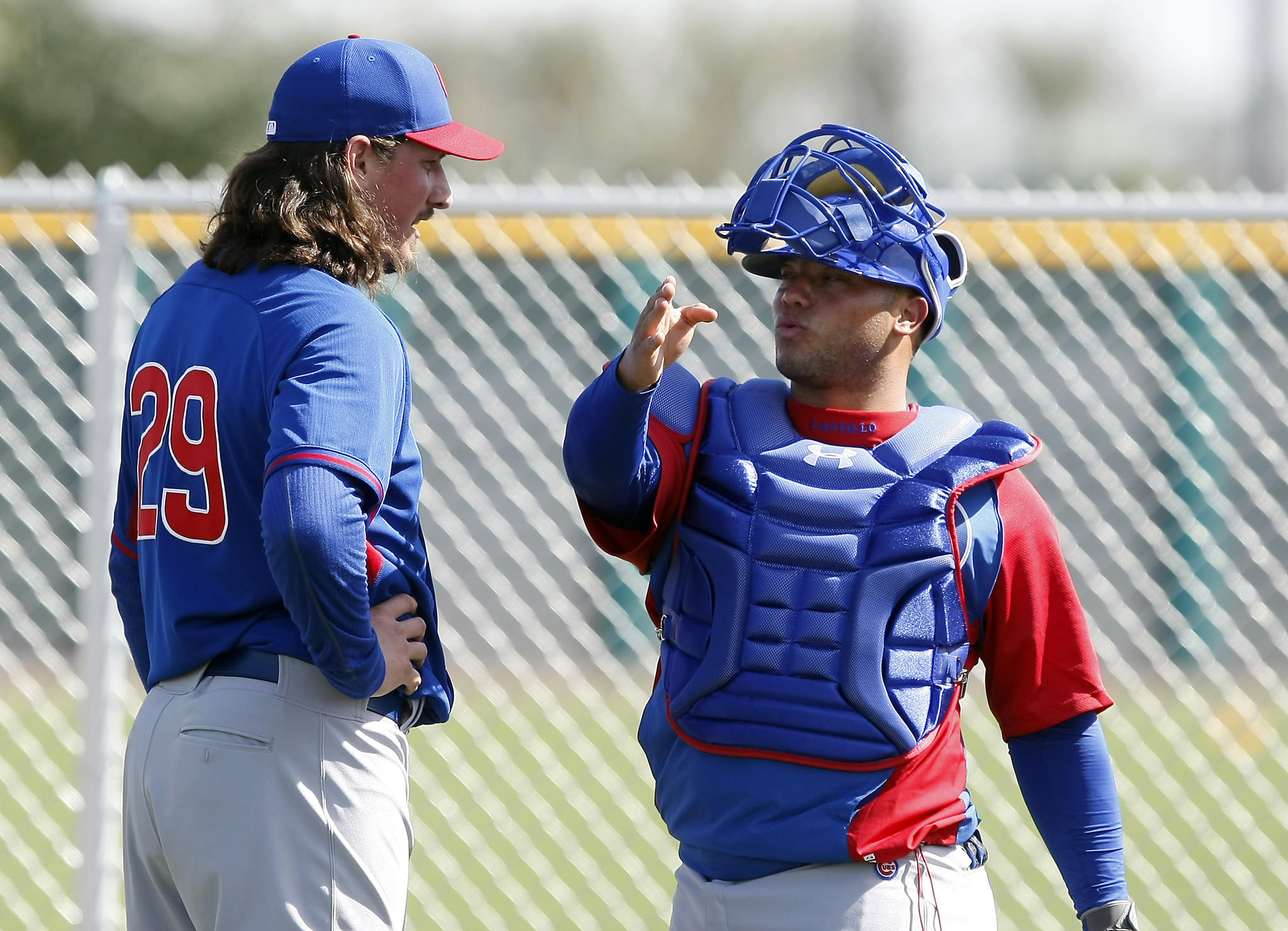 Chicago Cubs starting pitcher Jeff Samardzija (29) talks with catcher Welington Castillo (5) in the bullpen during camp at Chicago Cubs training facility at Mesa.