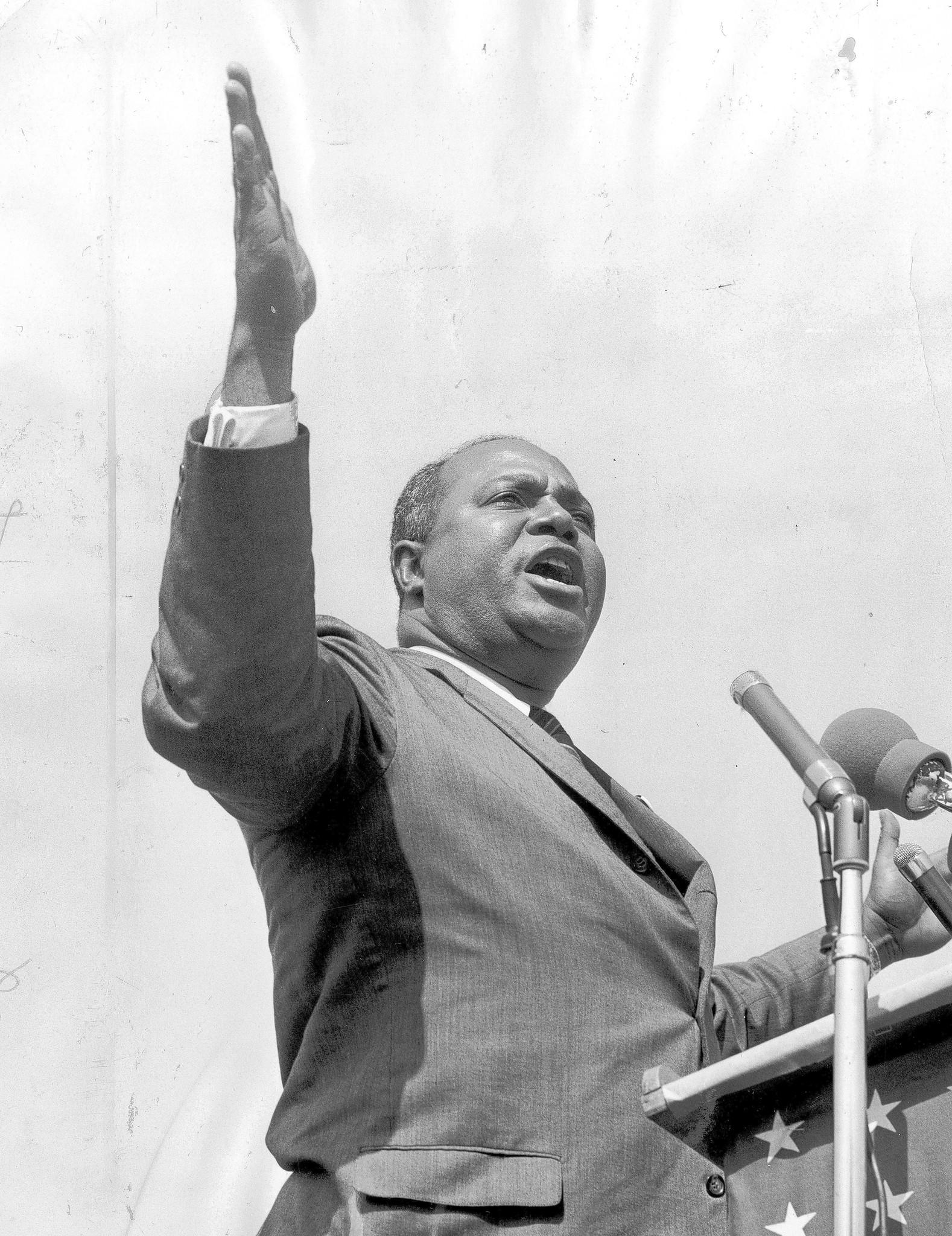 James Farmer, of the Congress of Racial Equality, speaks June 21, 1964, to more than 70,000 people at an Illinois Rally for Civil Rights event at Chicago's Soldier Field.