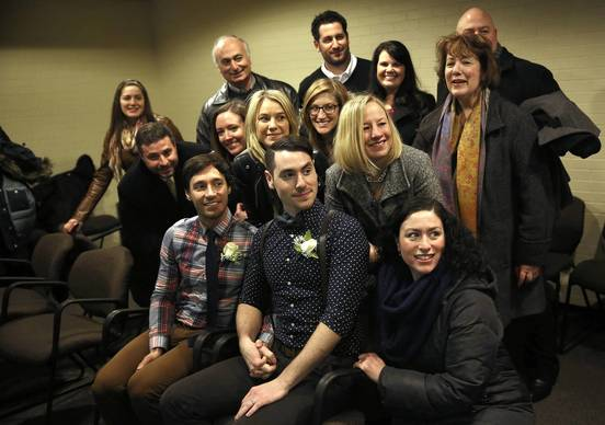 David Wilk and Charlie Gurion (front) pose for a picture with their family and friends before being married at the First Municipal District Marriage and Civil Union Court, following a federal court order that couples should not have to wait until the Illinois law goes into effect on June 1.