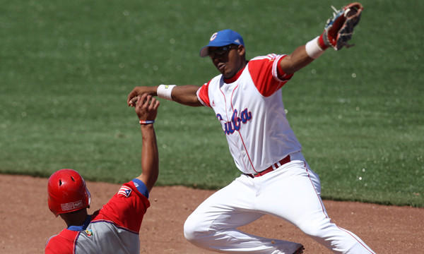Puerto Rico's Reymond Fuentes slides safely in front of Cuba shotstop Erisbel Arruebarrena during a game at the 2011 Pan American Games in Mexico. Arruebarrena has signed with the Dodgers.