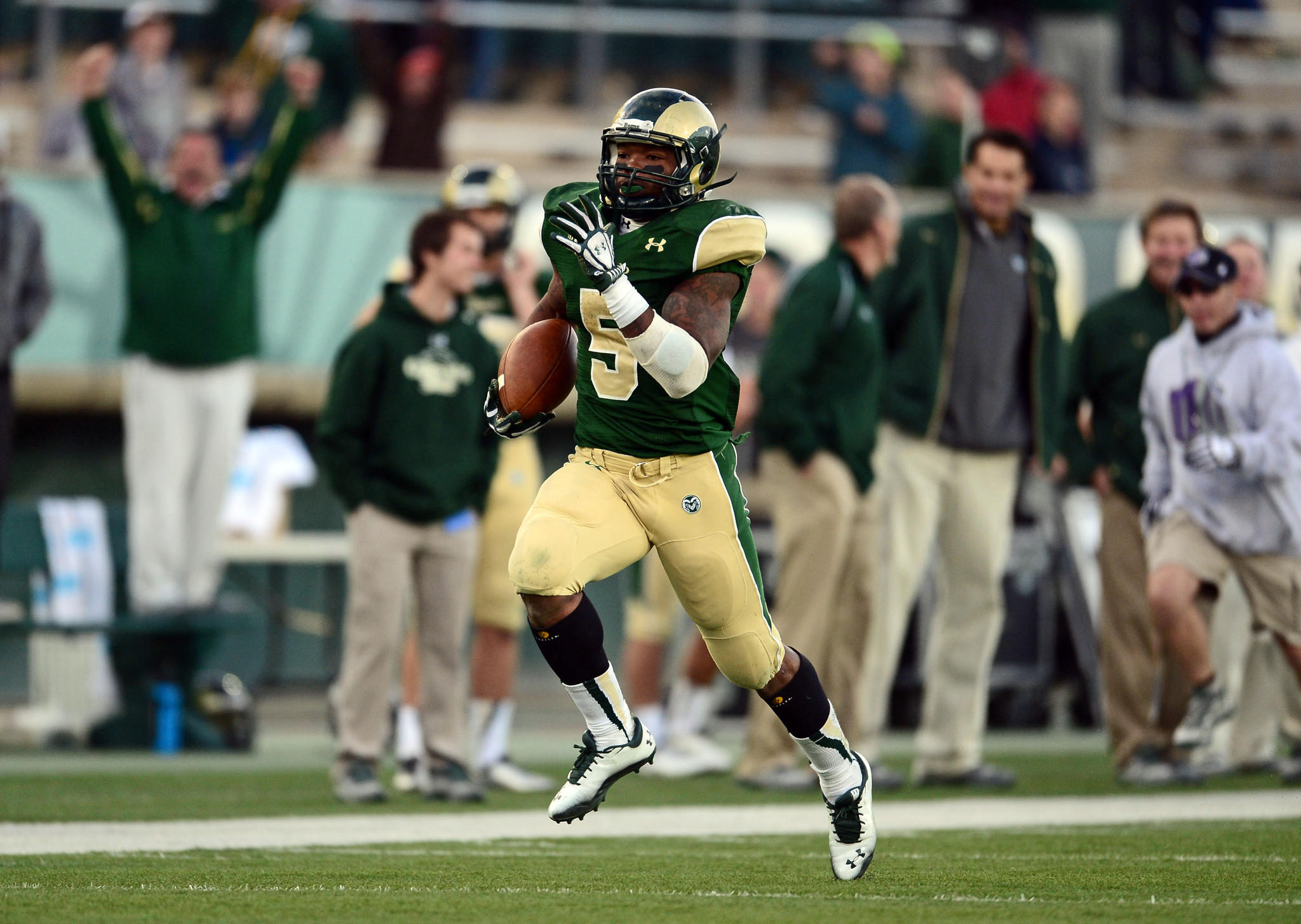 Colorado State Rams running back Kapri Bibbs (5) runs for a eighty five yard touchdown in the fourth quarter at Hughes Stadium. The Rams defeated the Wolf Pack 38-17.