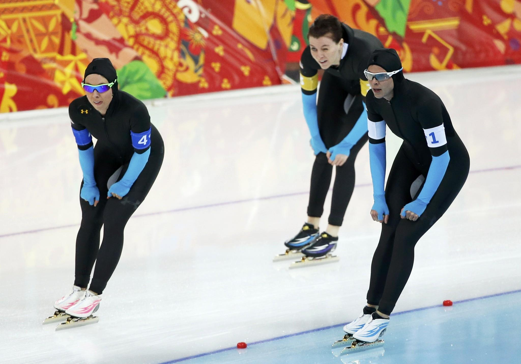 Jilleanne Rookard (L-R) of the U.S., Heather Richardson and Brittany Bowe react after the women's speed skating team pursuit finals event at the Adler Arena in the Sochi 2014 Winter Olympic Games February 22, 2014.