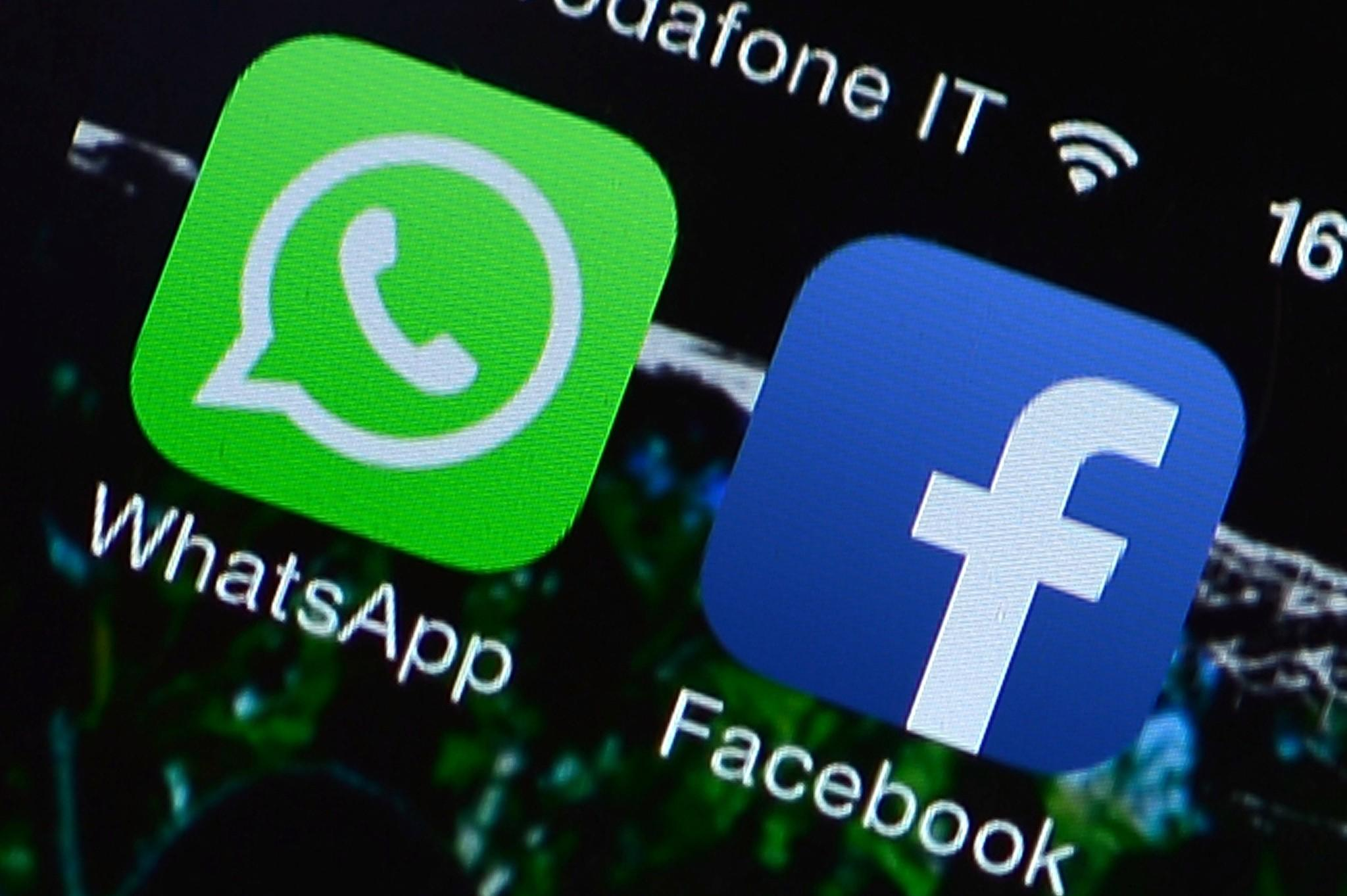 This file picture taken on Feb. 20 shows the Facebook and WhatsApp applications' icons displayed on a smartphone in Rome. Facebook's stunning $19 billion deal for messaging service WhatsApp places the social network in an arena where competition is fierce, particularly in Asia, where fast-growing chat rivals dominate their home markets.